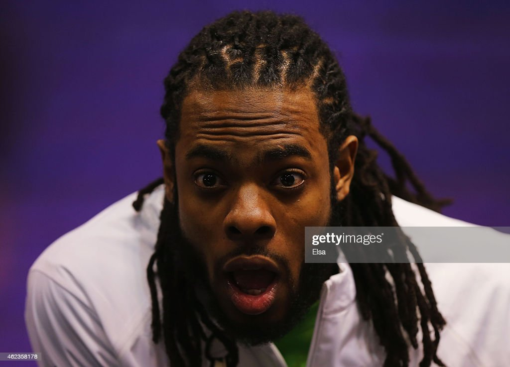 Richard Sherman of the Seattle Seahawks addresses the media at Super Bowl XLIX Media Day Fueled by Gatorade inside US Airways Center on January 27...