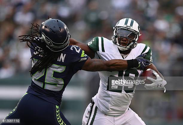 Richard Sherman of the Seattle Seahawks attempts to tackle Bilal Powell of the New York Jets in the first half at MetLife Stadium on October 2 2016...