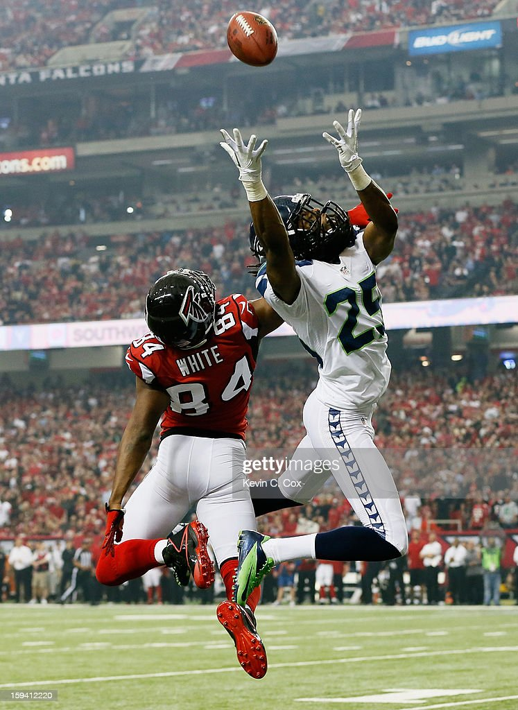 Richard Sherman #25 of the Seattle Seahawks breaks up a pass intended for Roddy White #84 of the Atlanta Falcons during the NFC Divisional Playoff Game at Georgia Dome on January 13, 2013 in Atlanta, Georgia.