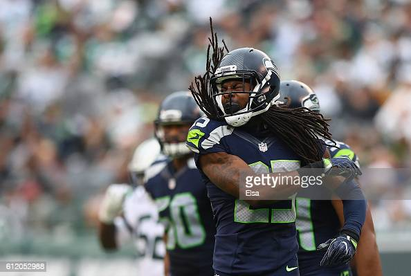 Richard Sherman of the Seattle Seahawks celebrates an interception in the third quarter against the New York Jets at MetLife Stadium on October 2...