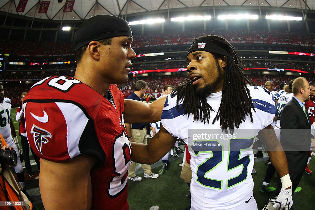 Richard Sherman #25 of the Seattle Seahawks congratulates Tony Gonzalez #88 of the Atlanta Falcons after the Falcons defeated the Seahawks 30 to 28 during the NFC Divisional Playoff Game at Georgia Dome on January 13, 2013 in Atlanta, Georgia.