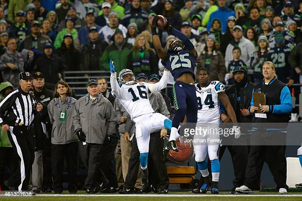 Richard Sherman of the Seattle Seahawks intercepts a ball intended for Philly Brown of the Carolina Panthers thrown by Cam Newton in the first...
