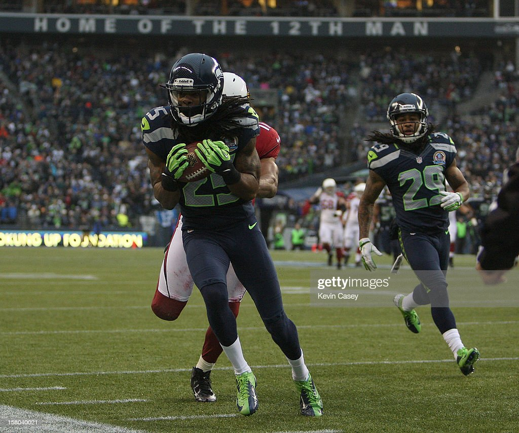 Richard Sherman #25 of the Seattle Seahawks intercepts a pass in front of intended receiver Larry Fitzgerald #11 of the Arizona Cardinals at CenturyLink Field on December 9, 2012 in Seattle, Washington.