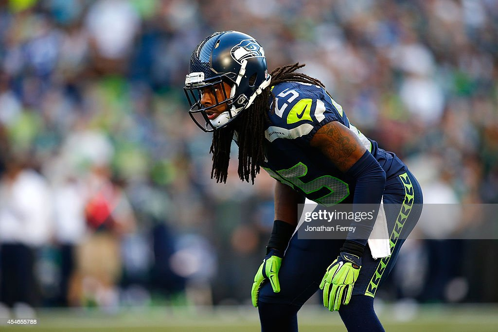 Richard Sherman of the Seattle Seahawks lines up on defense against the Green Bay Packers at CenturyLink Field on September 4 2014 in Seattle...