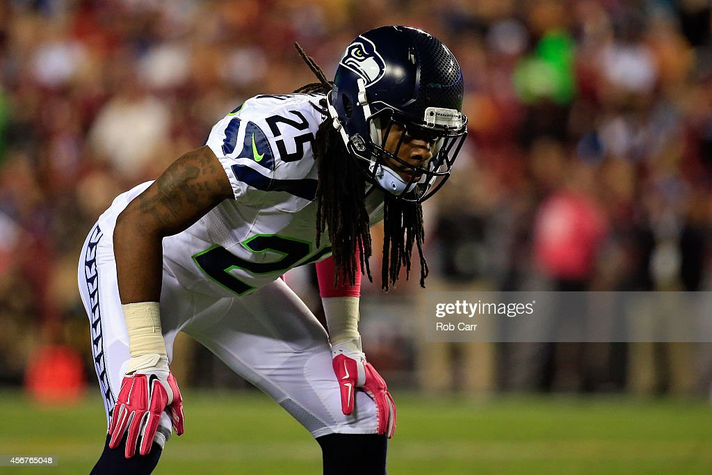 Richard Sherman of the Seattle Seahawks looks on against Washington Redskins at FedExField on October 6 2014 in Landover Maryland