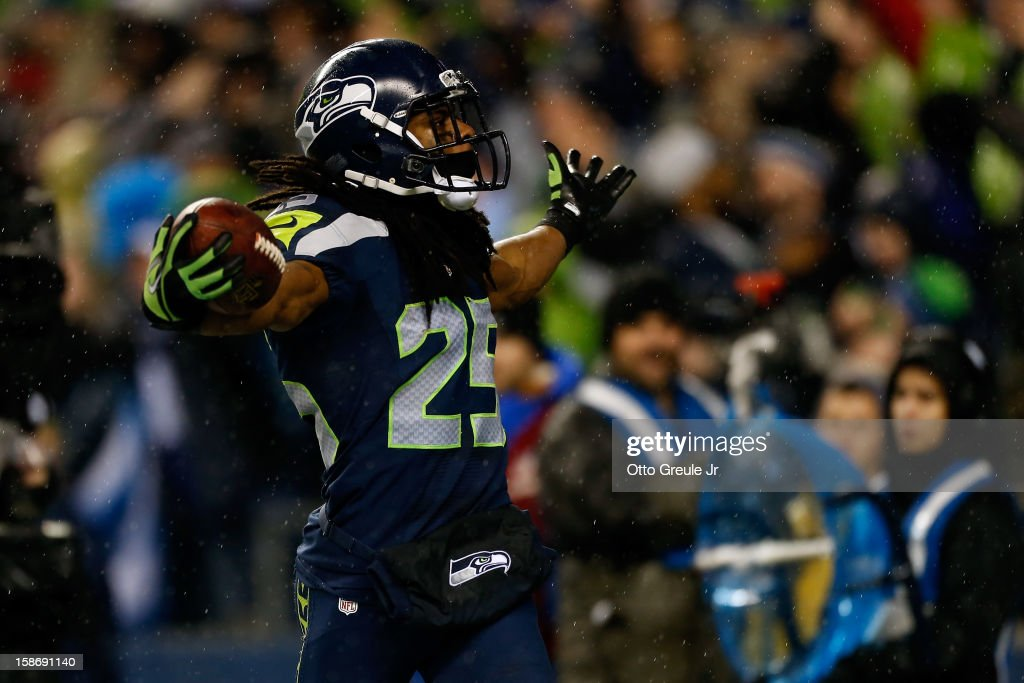 Richard Sherman of the Seattle Seahawks reacts after ne intercepted a pass in the second half against the San Francisco 49ers at Qwest Field on...