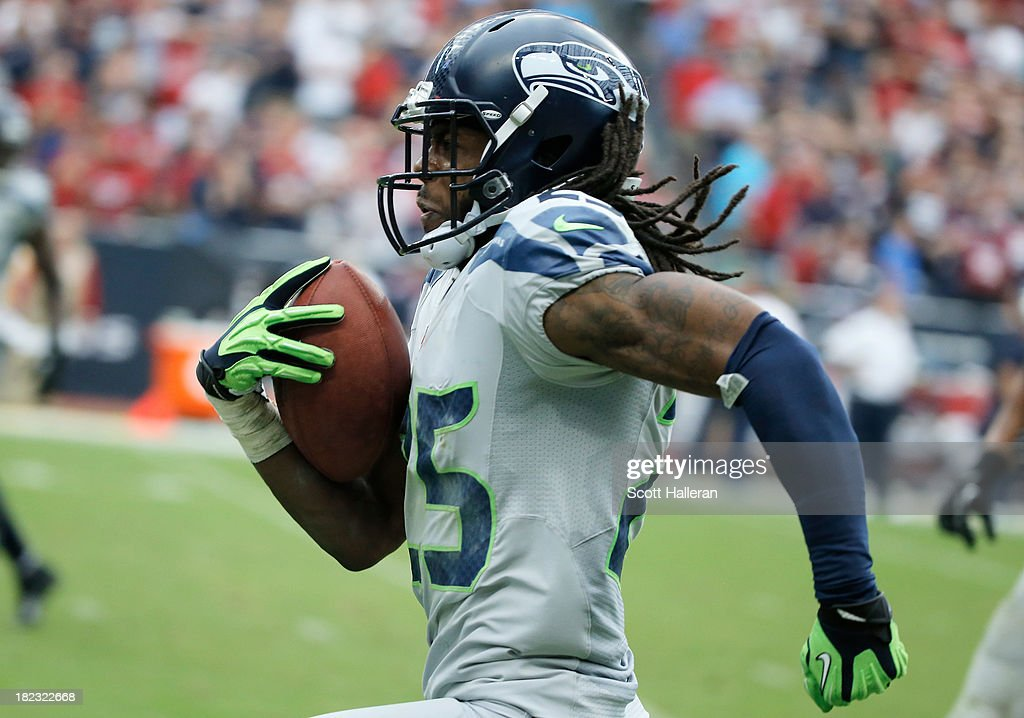 <a gi-track='captionPersonalityLinkClicked' href=/galleries/search?phrase=Richard+Sherman+-+American+Football+Player&family=editorial&specificpeople=9857648 ng-click='$event.stopPropagation()'>Richard Sherman</a> #25 of the Seattle Seahawks returns an interception 58 yaerds for a touchdown in the second half against the Houston Texans at Reliant Stadium on September 29, 2013 in Houston, Texas.
