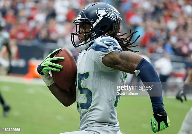 Richard Sherman of the Seattle Seahawks returns an interception 58 yaerds for a touchdown in the second half against the Houston Texans at Reliant...