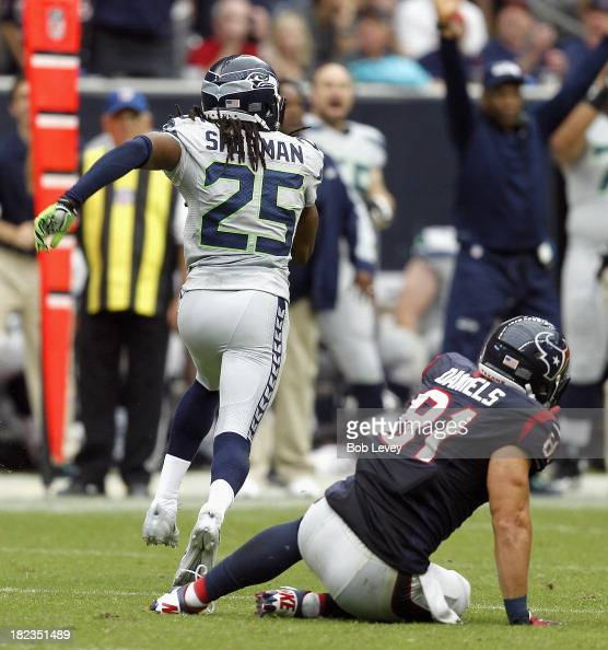 Richard Sherman of the Seattle Seahawks steps in front of Owen Daniels of the Houston Texans for a pick six interception at Reliant Stadium on...