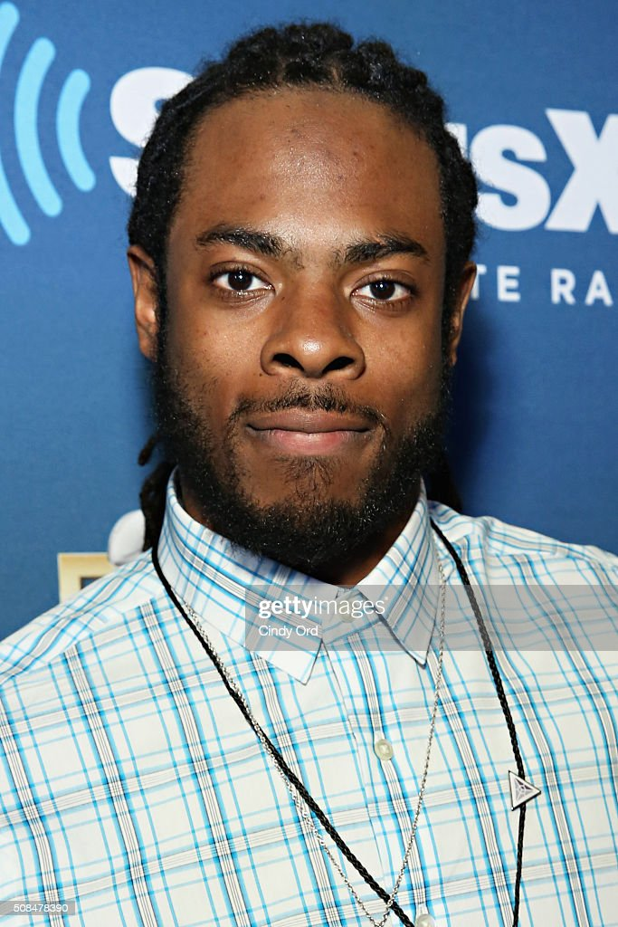 Richard Sherman of the Seattle Seahawks visits the SiriusXM set at Super Bowl 50 Radio Row at the Moscone Center on February 4 2016 in San Francisco...
