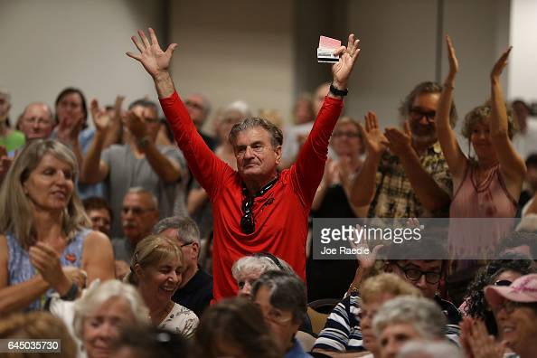 Richard Silvestri reacts as Rep Brian Mast speaks during a town hall meeting at the Havert L Fenn Center on February 24 2017 in Fort Pierce Florida...