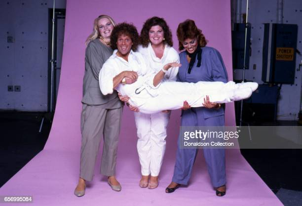 Richard Simmons poses for a portrait session with 3 women in 1984 in Los Angeles California
