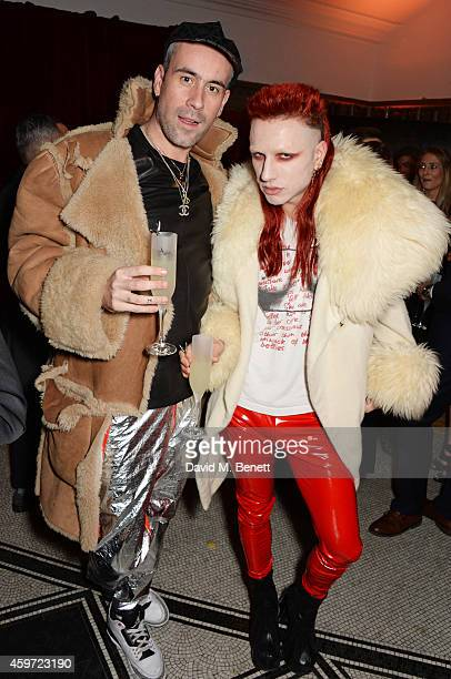 Richard Sloan and Josh Quinton attend the British Fashion Awards Nominees' Dinner hosted by Grey Goose at the Soho House PopUp on November 29 2014 in...