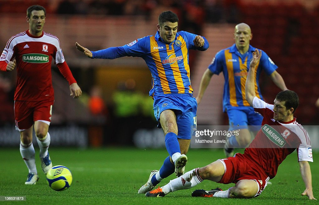 Richard Smallwood of Middlesbrough tackles Terry Gornell of Shrewsbury during the FA Cup Third Round match between Middlesbrough and Shrewsbury Town at Riverside Stadium on January 7, 2012 in Middlesbrough, England.