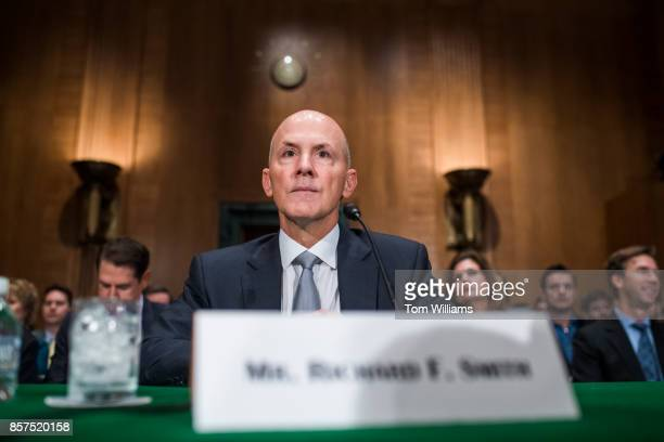 Richard Smith CEO of Equifax prepares to testify during a Senate Banking Housing and Urban Affairs Committee hearing in Dirksen on the company's...