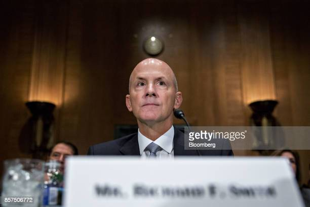 Richard Smith former chairman and chief executive officer of Equifax Inc waits to begin a Senate Banking Committee hearing in Washington DC US on...