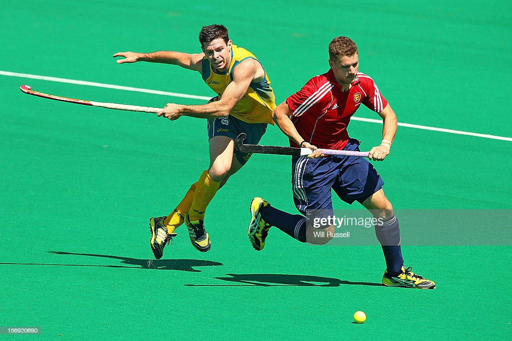 Richard Smith of England fends off Trent Mitton of the Kookaburras in the Australia v England final during day four of the 2012 International Super Series at Perth Hockey Stadium on November 25, 2012 in Perth, Australia.