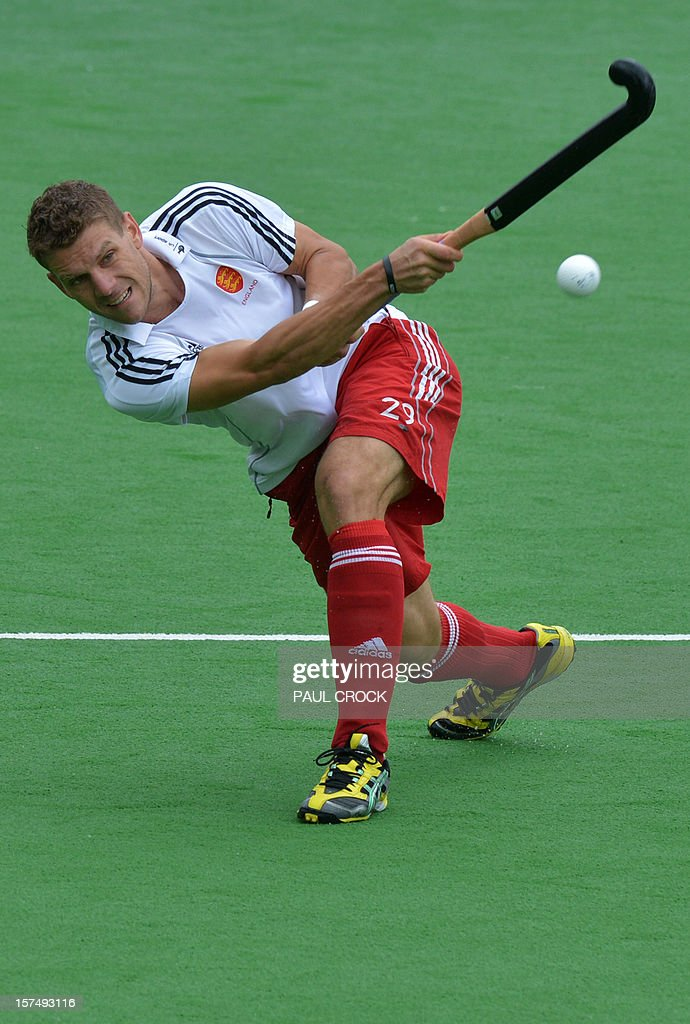 Richard Smith of England lofts the ball down the pitch during their Pool A match against England at the Men's Hockey Champions Trophy tournament in Melbourne on December 4, 2012. AFP PHOTO / Paul CROCK