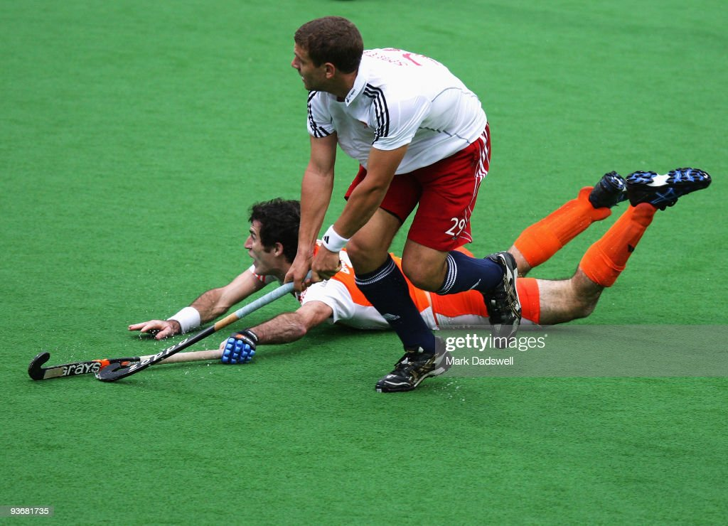 Richard Smith of England watches his shot on goal in the match between England and the Netherlands during day four of the 2009 Hockey Champions...