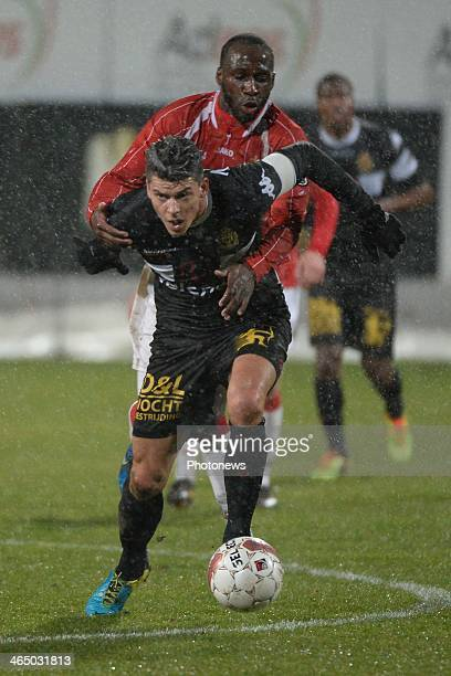 Richard Soumah of Mons and Seth De Witte pictured during the Jupiler League match between Raec Mons and KV Mechelen on January 25 2014 in Mons Belgium