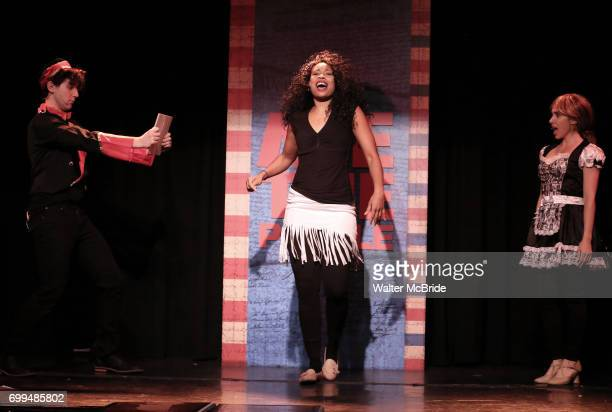 Richard Spitaletta Aiesha Dukes and Mia Weinberger perform onstage during the 'ME THE PEOPLE The Trump America Musical' Press Preview Presentation at...