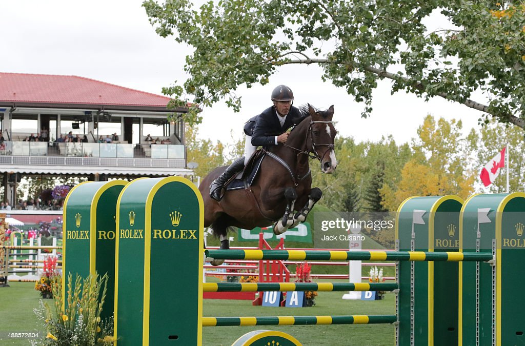 Richard Spooner of USA riding Cristallo clears a jump at the Rolex Grand Slam and the CP International Grand Prix at the Spruce Meadows Masters show...