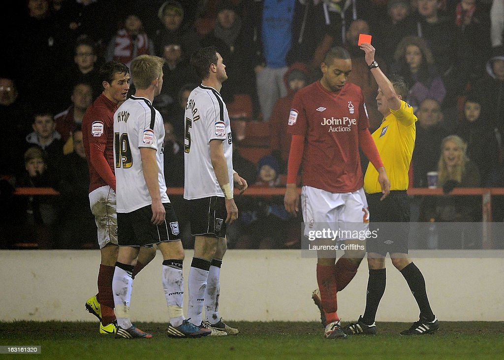 Richard Stearman of Ipswich is shown the red card after his second bookable offence during the npower Championship match between Nottingham Forest and Ipswich Town at City Ground on March 5, 2013 in Nottingham, England.