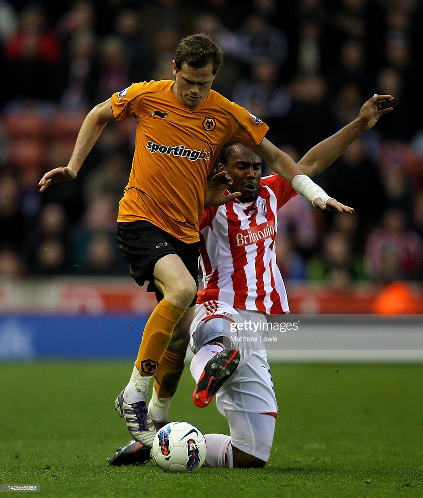 Richard Stearman of Wolverhampton Wanderers tangles with <a gi-track='captionPersonalityLinkClicked' href=/galleries/search?phrase=Cameron+Jerome&family=editorial&specificpeople=815275 ng-click='$event.stopPropagation()'>Cameron Jerome</a> of Stoke City during the Barclays Premier League match between Stoke City and Wolverhampton Wanderers at the Britannia Stadium on April 7, 2012 in Stoke on Trent, England.