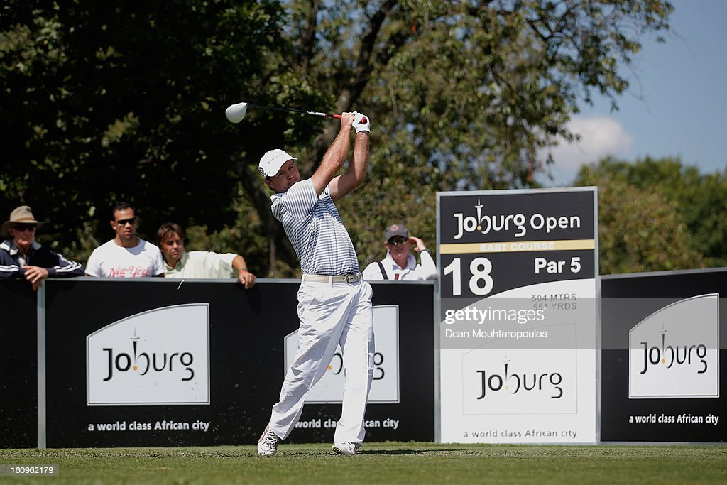 <a gi-track='captionPersonalityLinkClicked' href=/galleries/search?phrase=Richard+Sterne&family=editorial&specificpeople=243113 ng-click='$event.stopPropagation()'>Richard Sterne</a> of South Africa hits his tee shot on the 18th hole during Day Two of the Joburg Open at Royal Johannesburg and Kensington Golf Club on February 8, 2013 in Johannesburg, South Africa.
