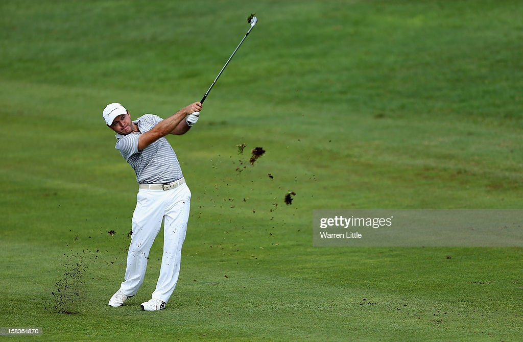 <a gi-track='captionPersonalityLinkClicked' href=/galleries/search?phrase=Richard+Sterne&family=editorial&specificpeople=243113 ng-click='$event.stopPropagation()'>Richard Sterne</a> of South Africa plays his second shot into the 14th green during the second round of the Alfred Dunhill Championship at Leopard Creek Country Golf Club on December 14, 2012 in Malelane, South Africa.