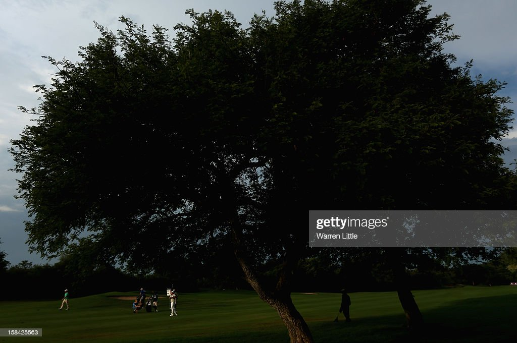 Richard Sterne of South Africa plays his second shot into the 17th green during the final round of the Alfred Dunhill Championship at Leopard Creek Country Golf Club on December 16, 2012 in Malelane, South Africa.