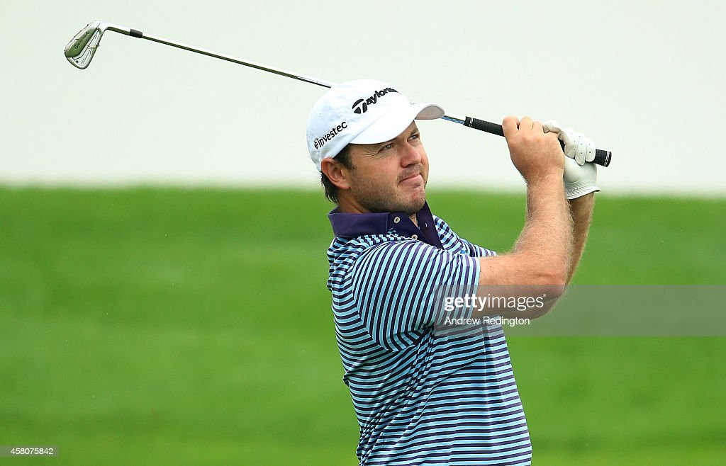<a gi-track='captionPersonalityLinkClicked' href=/galleries/search?phrase=Richard+Sterne&family=editorial&specificpeople=243113 ng-click='$event.stopPropagation()'>Richard Sterne</a> of South Africa plays his second shot on the tenth hole during the first round of the BMW Masters at Lake Malaren Golf Club on October 30, 2014 in Shanghai, China.