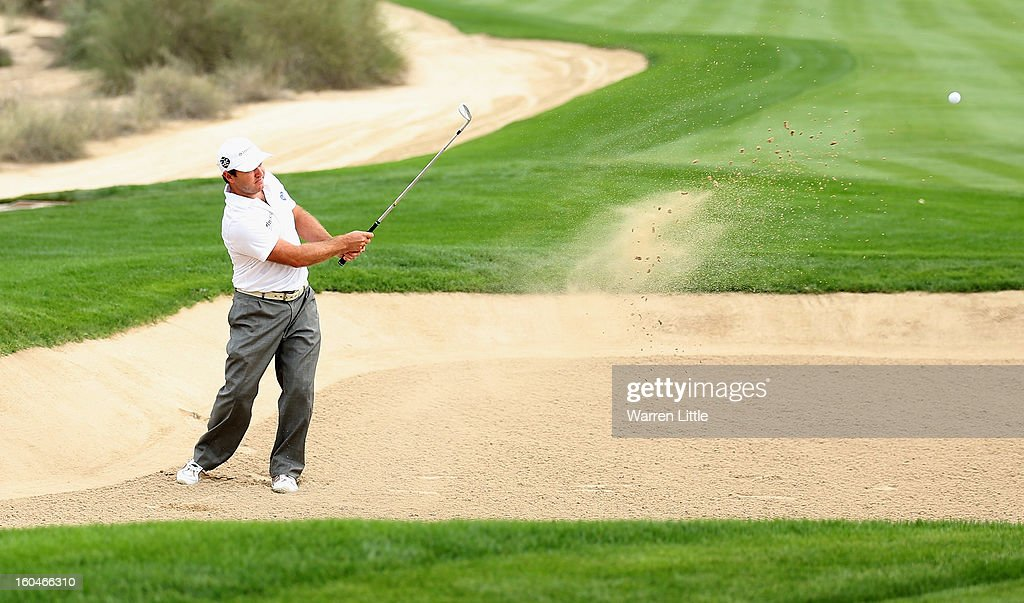 Richard Sterne of South Africa plays out of the eighth greenside bunker during the second round of the Omega Dubai Desert Classic at Emirates Golf Club on February 1, 2013 in Dubai, United Arab Emirates.