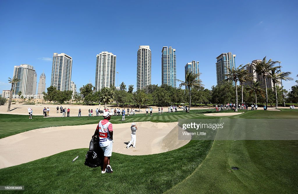 Richard Sterne of South Africa plays out of the third greenside bunker during the final round of the Omega Dubai Desert Classic at Emirates Golf Club on February 3, 2013 in Dubai, United Arab Emirates.
