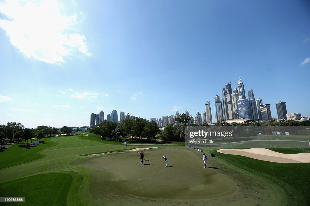 Richard Sterne of South Africa putts on the first green during the final round of the Omega Dubai Desert Classic at Emirates Golf Club on February 3, 2013 in Dubai, United Arab Emirates.
