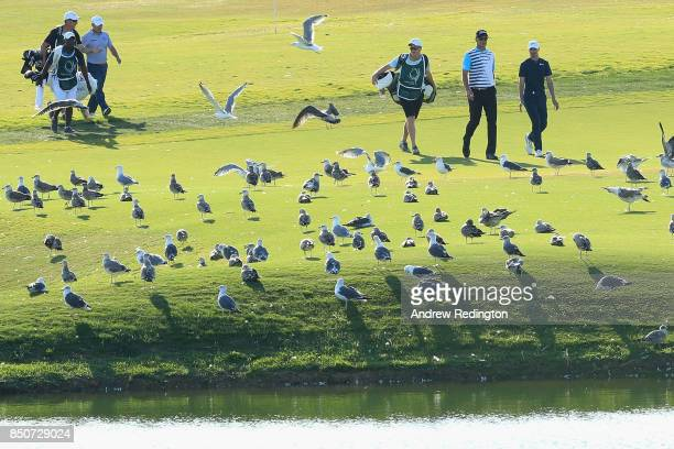 Richard Sterne of South Africa Robert Karlsson of Sweden and Paul Peterson of The United States make their way down the fairwayduring day one of the...