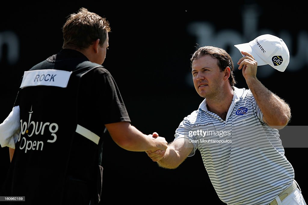 <a gi-track='captionPersonalityLinkClicked' href=/galleries/search?phrase=Richard+Sterne&family=editorial&specificpeople=243113 ng-click='$event.stopPropagation()'>Richard Sterne</a> (R) of South Africa shakes hands with caddie, <a gi-track='captionPersonalityLinkClicked' href=/galleries/search?phrase=Tom+Whitehouse&family=editorial&specificpeople=588996 ng-click='$event.stopPropagation()'>Tom Whitehouse</a> on the 18th green after his round on Day Two of the Joburg Open at Royal Johannesburg and Kensington Golf Club on February 8, 2013 in Johannesburg, South Africa.