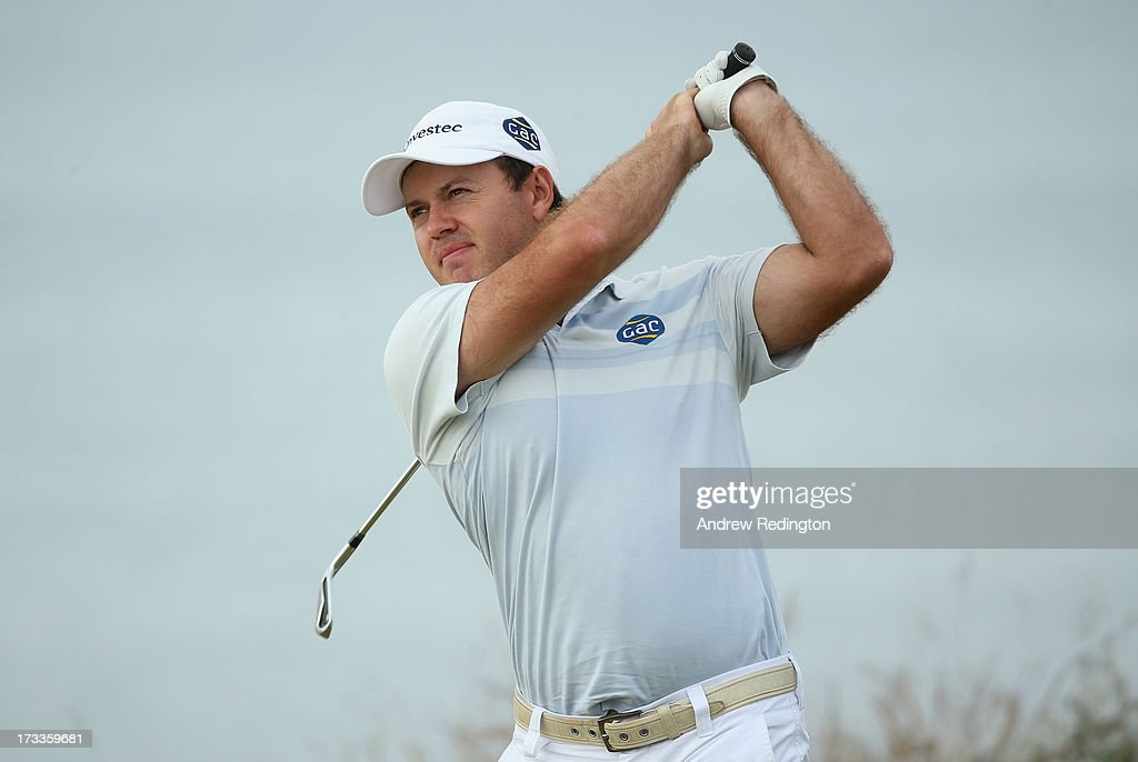 <a gi-track='captionPersonalityLinkClicked' href=/galleries/search?phrase=Richard+Sterne&family=editorial&specificpeople=243113 ng-click='$event.stopPropagation()'>Richard Sterne</a> of South Africa tees off during the second round of the Aberdeen Asset Management Scottish Open at Castle Stuart Golf Links on July 12, 2013 in Inverness, Scotland.