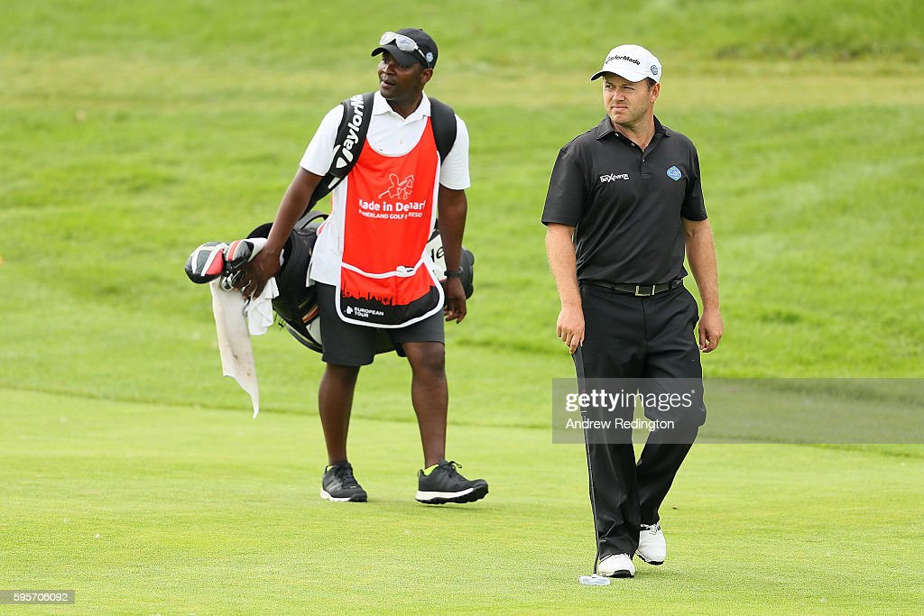 Richard Sterne of South Africa walks down the 18th hole with his caddie during the second round of Made in Denmark at Himmerland Golf Spa Resort on...