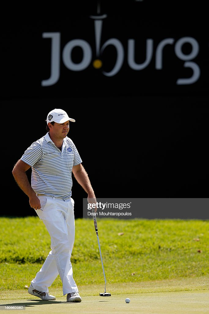 <a gi-track='captionPersonalityLinkClicked' href=/galleries/search?phrase=Richard+Sterne&family=editorial&specificpeople=243113 ng-click='$event.stopPropagation()'>Richard Sterne</a> of South Africa walks on the 18th green during Day Two of the Joburg Open at Royal Johannesburg and Kensington Golf Club on February 8, 2013 in Johannesburg, South Africa.