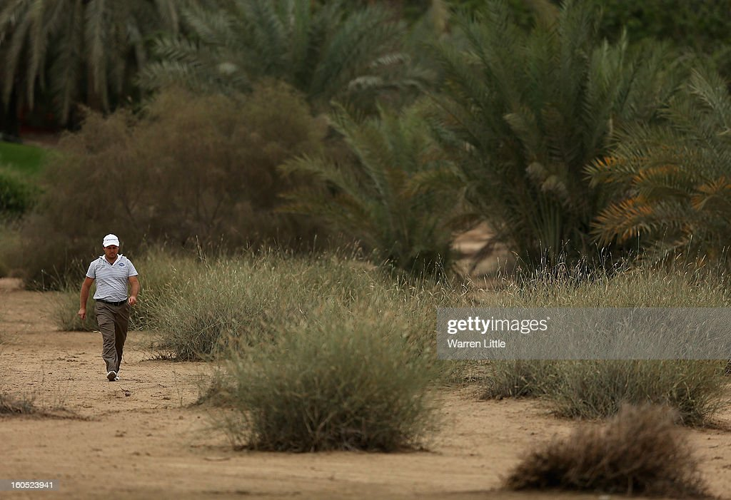 Richard Sterne of South Africa walks through the sand towards 16th fairway during the third round of the Omega Dubai Desert Classic at Emirates Golf Club on February 2, 2013 in Dubai, United Arab Emirates.