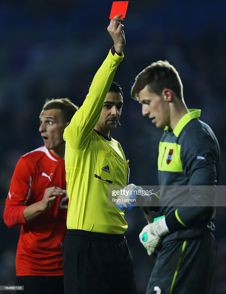 Richard Strebinger of Austria is sent off by referee Adrien Jaccottetduring the International Friendly match between England U21 and Austria U21 at Amex Stadium on March 25, 2013 in Brighton, England.