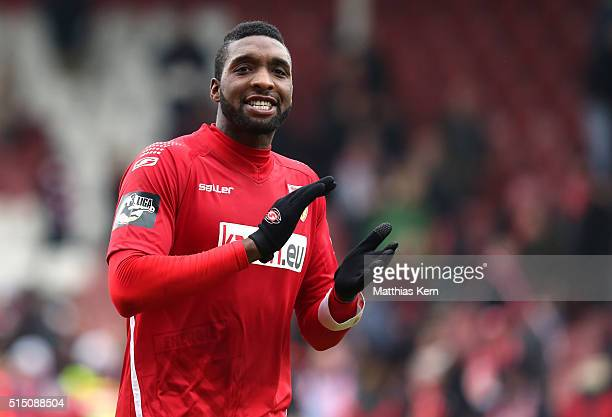 Richard Sukuta Pasu of Cottbus shows his delight after winning the third league match between FC Energie Cottbus and 1FC Magdeburg at Stadion der...