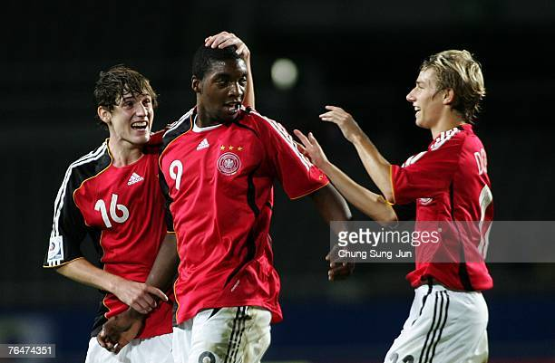 Richard SukutaPasu of Germany celebrates with his team mates after his second goal for Germany during the FIFA U17 World Cup quarter final match...