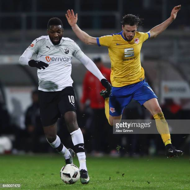 Richard SukutaPasu of Sandhausen is challenged by Quirin Moll of Braunschweig during the Second Bundesliga match between SV Sandhausen and Eintracht...