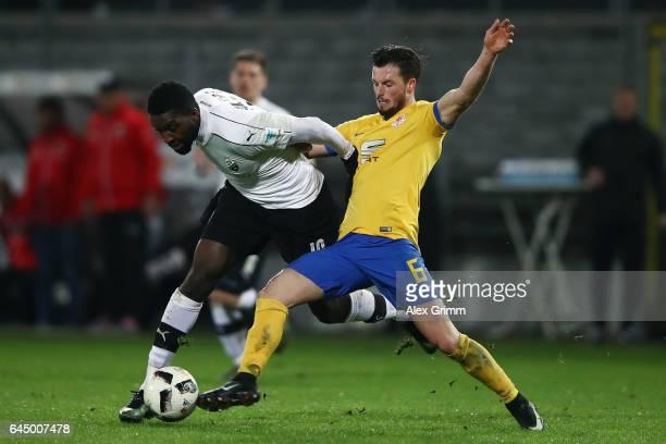 Richard SukutaPasu of Sandhausen is challenged by Quirin Moll of Braunschweig during the Second Bundesliga match between SV Sandhausen and Eintracht...