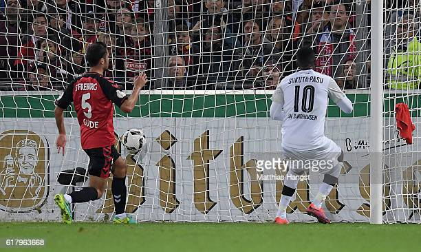 Richard SukutaPasu of Sandhausen scores his team's third goal during the DFB Cup match between SC Freiburg and SV Sandhausen at SchwarzwaldStadion on...