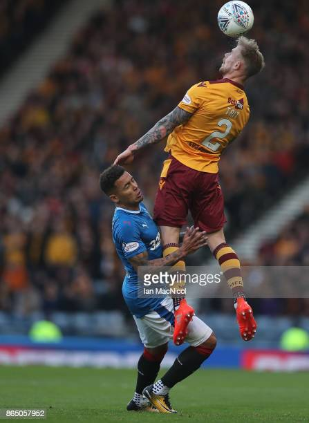 Richard Tait of Motherwell vies with James Tavernier of Rangers during the Betfred League Cup Semi Final between Rangers and Motherwell at Hampden...