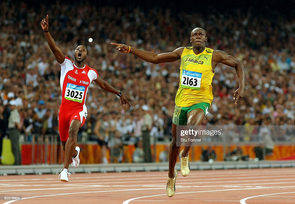 Richard Thompson of Trinidad and Tobago and Usain Bolt of Jamaica celebrate as they cross the line in the Men's 100m Final at the National Stadium on Day 8 of the Beijing 2008 Olympic Games on August 16, 2008 in Beijing, China. Bolt of Jamaica finished the event in first place with a time of 9.69, a new World Record. Thompson claimed silver.