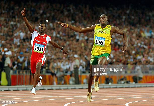 Richard Thompson of Trinidad and Tobago and Usain Bolt of Jamaica celebrate as they cross the line in the Men's 100m Final at the National Stadium on...